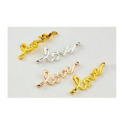 """Köztes elem """"love"""", arany szín, méret:39x14x5mm, lyuk: 2.5mm"""