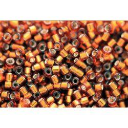 Delica gyöngy 11/0, DB0144, ezüst közepű borostyán, 4g
