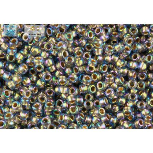 Japán kásagyöngy TOHO 11/0, aranyközepű szivárványos világos zafír, 10g